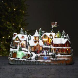 Stor julby med tåg och skridskor