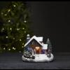 Vinterlandskap med barn och snögubbe
